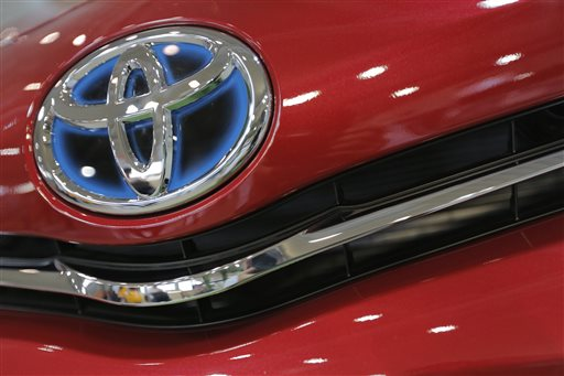 In this Aug. 2, 2013 file photo, the emblem of a Toyota car shines at Toyota Motor Corp.'s showroom Toyota Mega Web in Tokyo. Toyota Motor Corp. is recalling 6.39 million vehicles globally for a variety of problems spanning nearly 30 models in Japan, the U.S., Europe and other places. No injuries or crashes have been reported related to the recalls announced Wednesday, April 9, 2014. But two fires have been reported related to one of the problems, a defective engine starter that can keep the motor running. (AP Photo/Itsuo Inouye, File)