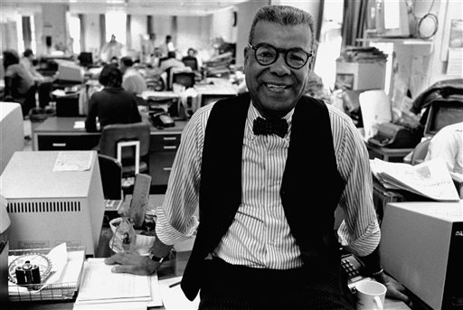 """In this Feb. 15, 1984, file photo, newspaper columnist Chuck Stone poses in the newsroom of the Daily News in Philadelphia. Longtime journalist and educator Charles Sumner """"Chuck"""" Stone Jr., one of the founders of the National Association of Black Journalists, has died. He was 89. Allegra Stone said that her father died Sunday, April 6, 2014, at an assisted living facility in Chapel Hill. He'd been a journalism professor at the University of North Carolina for 14 years starting in 1991. (AP Photo/File)"""