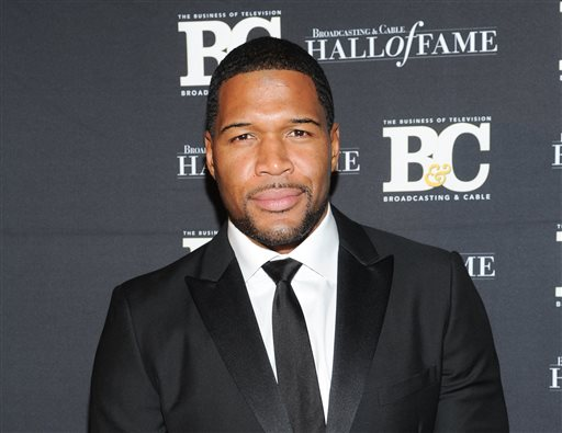 "This Oct. 28, 2013 file photo shows former professional football player Michael Strahan, co-host of ""Live with Kelly and Michael,"" attending the 23rd Annual Broadcasting & Cable Hall of Fame Awards in New York. (Photo by Evan Agostini/Invision/AP, File)"