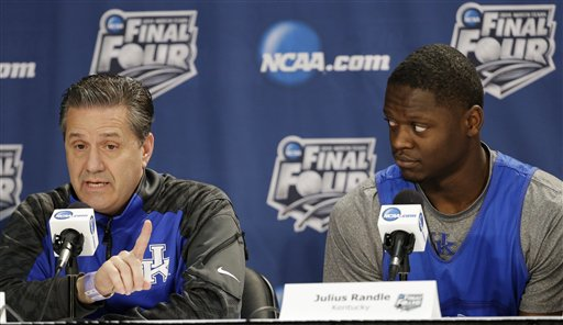 Kentucky head coach John Calipari, left, answers a question as forward Julius Randle looks on during a news conference for the NCAA Final Four tournament college basketball championship game Sunday, April 6, 2014, in Arlington, Texas. Kentucky plays Connecticut in the championship game on Monday, April 7. 2014. (AP Photo/Tony Gutierrez)