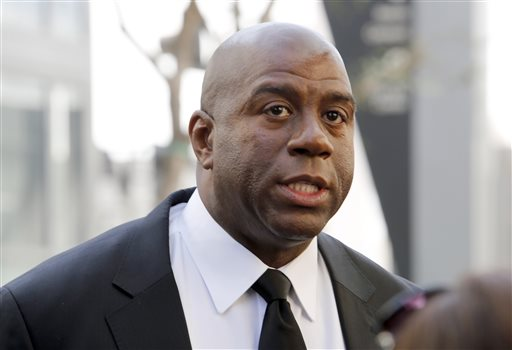 """In this Feb. 21, 2013, file photo, former Los Angeles Lakers player Earvin """"Magic"""" Johnson arrives at a memorial service for Jerry Buss in Los Angeles. Johnson is calling upon NBA Commissioner Adam Silver to """"come down hard"""" on Los Angeles Clippers owner Donald Sterling, who is alleged to have made racially charged comments. Johnson was a subject of the comments Sterling allegedly made on an audio recording obtained and released by TMZ. (AP Photo/Reed Saxon, File)"""