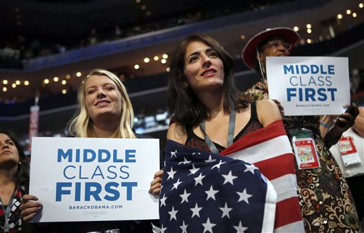 In this Sept. 5, 2012, file photo, delegates watch as former President Bill Clinton addresses the Democratic National Convention in Charlotte, N.C. Since 2008, the number of people who call themselves middle class has fallen by a fifth, according to a survey in January 2014 by the Pew Research Center, from 53 percent to 44 percent. (AP Photo/Jae C. Hong, File)