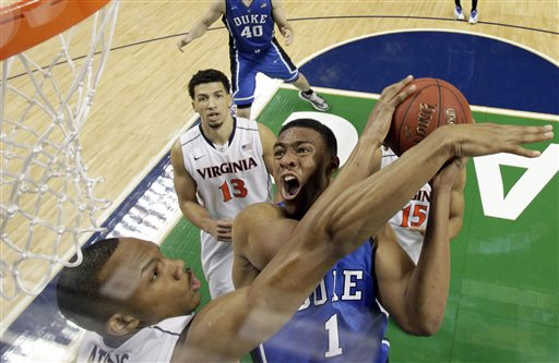 In this March 16, 2014 file photo, Duke's Jabari Parker (1) tries to shoot over Virginia's Darion Atkins during the first half of an NCAA college basketball game in the championship of the Atlantic Coast Conference tournament in Greensboro, N.C. Parker was selected to The Associated Pressnam All-America team, released Monday, March 31, 2014.  (AP Photo/Bob Leverone, File)