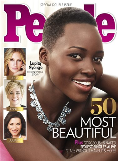 """This image provided by People magazine shows the cover of its special """"World's Most Beautiful"""" issue, featuring Lupita Nyong'o.  The 31-year-old actress, who won a best supporting actress Oscar for her role in """"12 Years a Slave,"""" tops the magazine's list, announced Wednesday, April 23, 2014. (AP Photo/People)"""