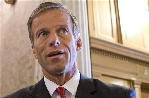 This July 1, 2013 file photo shows Sen. John Thune, R-S.D. speaking with reporters on Capitol Hill in Washington.  A bill to renew a package of more than 50 expired tax breaks cleared its first hurdle in the Senate Tuesday. Other hurdles remain, however. The Senate voted 96 to 3 to open debate on the bill, which has strong backing from the business community but would add about $85 billion to the budget deficit. Almost every year, Congress routinely renews the tax breaks. This year, though, they were allowed to expire at the start of the year. The Senate bill would extend the tax breaks through 2015.  (AP Photo/J. Scott Applewhite, File)
