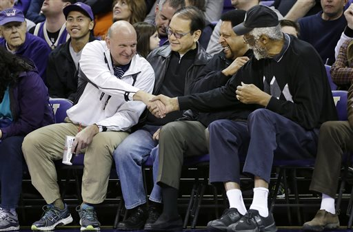 "In this Jan. 25, 2014, photo, then-Microsoft CEO Steve Ballmer, left, shakes hands with former NBA players Bill Russell, right, and ""Downtown"" Freddie Brown as Omar Lee looks on during an NCAA college basketball game between Washington and Oregon State in Seattle. An individual with knowledge of negotiations to sell the Los Angeles Clippers said Shelly Sterling has reached an agreement to sell the team to Ballmer for $2 billion. The individual, who wasn't authorized to speak publicly, told The Associated Press on Thursday, May 29, 2014, that Ballmer and the Sterling Family Trust now have a binding agreement. The deal now must be presented to the NBA. (AP Photo/Elaine Thompson, File)"