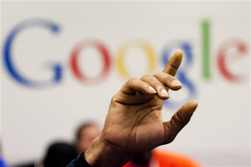 In this Oct. 17, 2012, file photo, a man raises his hand during at Google offices in New York. People should have some say over the results that pop up when they conduct a search of their own name online, Europe's highest court said Tuesday, May 13, 2014. (AP Photo/Mark Lennihan, File)