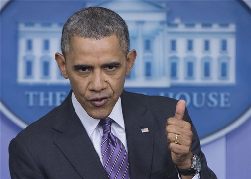 In this April 17, 2014, file photo, President Barack Obama gestures as he speaks in the White House briefing room in Washington. Blue or red, a majority of states have exceeded their health care sign-up targets under Obama's law, something that would have been hard to imagine after last fall's botched rollout of insurance markets. But the administration's final numbers, released Thursday, May 1, also expose shortcomings, including subpar enrollment among Hispanics, the nation's largest minority group and also its least insured. (AP Photo/Carolyn Kaster, File)