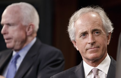 "Sen. Bob Corker, R-Tenn., right, accompanied by Sen. John McCain, R-Ariz., listens during a news conference on Capitol Hill in Washington, Wednesday, April 30, 2014. Corker was the only Republican to cross party lines and vote ""yes"" in favor of allowing debate on the Minimum Wage Fairness Act to proceed.  The measure was stopped in the Senate,  handing a defeat to President Barack Obama on a vote that is sure to reverberate in this year's congressional contests. (AP Photo)"