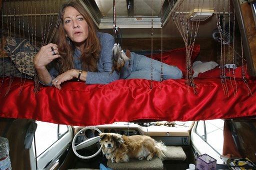 This June 4, 2008 photo shows Darlene Knoll, 53, resting in the sleeping area of the battered 1978 motor home where she lives in Los Angeles. A federal appeals court on Thursday, June 19, 2014, struck down a 31-year-old Los Angeles law that bars people from living in parked vehicles, saying the vaguely written statute discriminates against homeless and poor people. (AP Photo/Damian Dovarganes, file)
