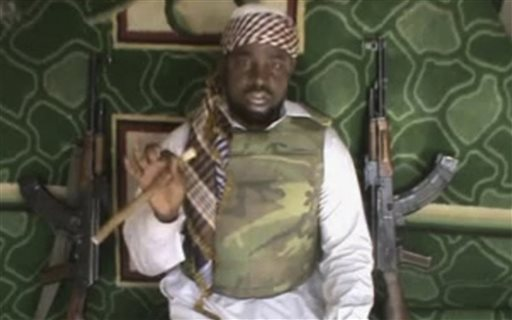 This file image made available from Wednesday, Jan. 10, 2012, taken from video posted by Boko Haram sympathizers shows Imam Abubakar Shekau, the leader of the radical Islamist sect. Boko Haram militants dressed as soldiers slaughtered at least 200 civilians in three villages in northeastern Nigeria and the military failed to intervene even though it was warned that an attack was imminent, witnesses said on Thursday, June 5, 2014. (AP Photo/File) THE ASSOCIATED PRESS CANNOT INDEPENDENTLY VERIFY THE CONTENT, DATE, LOCATION OR AUTHENTICITY OF THIS MATERIAL