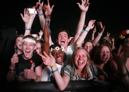 Fans scream as Kanye West performs at the Bonnaroo Music and Arts Festival on Friday, June 13, 2014, in Manchester, Tenn. (Photo by Wade Payne/Invision/AP)