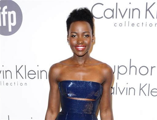 """FILE - This May 15, 2014 file photo shows Lupita Nyong'o at the IFP and Calvin Klein Women In Film Party at the 67th international film festival, Cannes, southern France. The Walt Disney Co. announced Monday, June 2, that Nyong'o is joining the cast of """"Star Wars: Episode VII."""""""" (AP Photo/Arthur Mola/Invision/File)"""