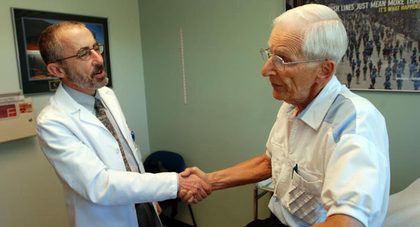 A senior citizen is pictured receiving medical care. (AP Photo)