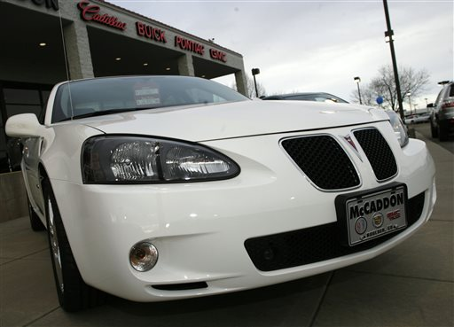"This Feb. 18, 2007, file photo shows an unsold 2006 Grand Prix sedan sitting outside a General Motors dealership in Boulder, Colo. General Motors' safety crisis worsened on Monday, June 30, 2014, when the automaker added 8.2 million vehicles to its huge list of cars recalled over faulty ignition switches. The latest recalls cover seven vehicles, including the Chevrolet Malibu from 1997 to 2005 and the Pontiac Grand Prix from 2004 to 2008. The recalls also cover a newer model, the 2003-2014 Cadillac CTS. GM said the recalls are for ""unintended ignition key rotation.""  (AP Photo/David Zalubowski, File)"