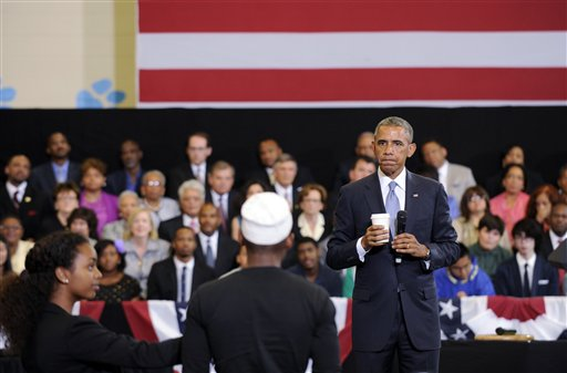 """President Barack Obama listens as he is asked a question at an event at the Walker Jones Education Campus in Washington, to announce additional commitments for """"My Brother's Keeper,"""" Obama's initiative aimed at helping boys and young men of color,  Monday, July 21, 2014. The commitments include an effort by the NBA to recruit 25,000 new mentors and work with at-risk students to increase attendance and performance.  (AP Photo/Susan Walsh)"""