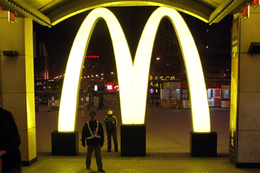 In this photo taken Saturday, May 21, 2011, a giant logo of fast food restaurant McDonald's is displayed at a train station in Shenyang in northern China's Liaoning province.  McDonald's and KFC in China faced a new food safety scare Monday, July 21, 2014 after a Shanghai television station reported a supplier sold them expired beef and chicken. (AP Photo/Ng Han Guan)
