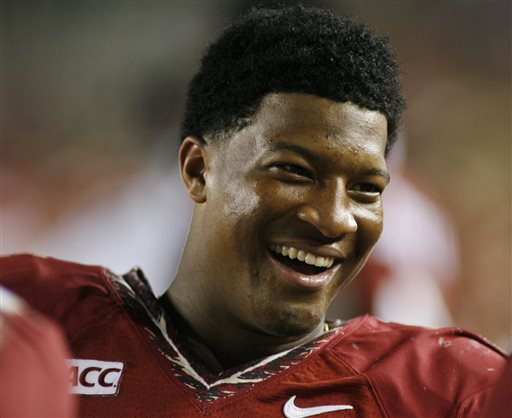 In this Nov. 16, 2013, file photo, Florida State quarterback Jameis Winston (5) smiles on the sidelines in the fourth quarter of an NCAA college football game against Syracuse in Tallahassee, Fla. Winston has the opportunity to accomplish what only one other player has achieved _ win consecutive Heisman trophies.  (AP Photo/Phil Sears, File)