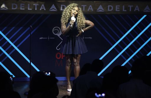 Tennis player Serena Williams performs onstage at the Delta Open Mic with Serena Williams event Wednesday, Aug. 20, 2014 in New York. (Photo by Andy Kropa/Invision/AP)