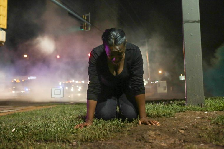 Peaceful protester gasping after being hit with tear gas by police (Lawrence Bryant/St. Louis American)