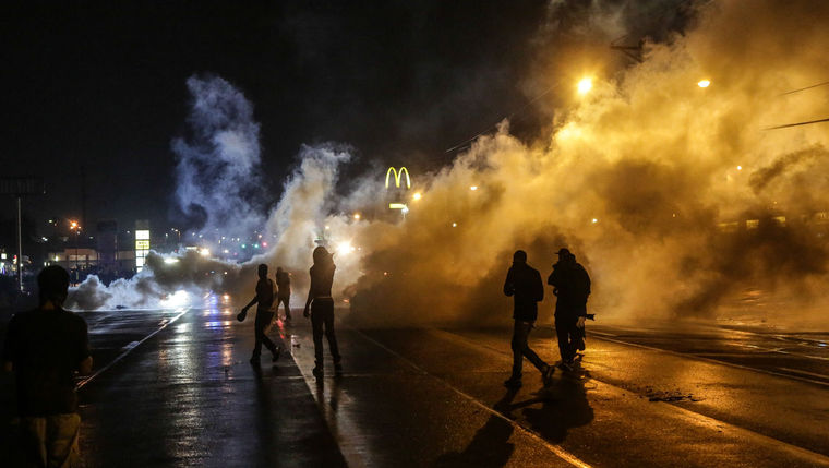 Protesting youth were stranded on the street after curfew when Missouri Gov. Jay Nixon declared a state of emergency and midnight-to-5 a.m. curfew in Ferguson. (Lawrence Bryant/St. Louis American)