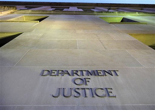 This May 14, 2013 file photo shows the Justice Department in Washington. The federal panel that sets sentencing policy eased penalties this year for potentially tens of thousands of drug prisoners. Now, defense lawyers and prisoner advocates are pushing for similar treatment for an arguably less-sympathetic category of inmates: white-collar criminals. It's unclear what action the commission will take, especially given the public outrage at fraudsters. But the discussion is unfolding as some federal judges have chosen to ignore the existing guidelines and as the Justice Department looks for ways to cut costs from an overpopulated federal prison system. (AP Photo/J. David Ake, File)