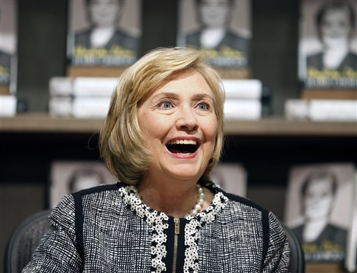 "This July 29, 2014, file photo shows former Secretary of State Hillary Rodham Clinton as she greets a customer during a book signing of her new book ""Hard Choices"" at Northshire Bookstore in Saratoga Springs, N.Y.  Clinton has made her most aggressive effort yet to distinguish herself from her former boss, rebuking President Barack Obama for his cautious approach to global crises and saying foreign policy has to go beyond ""don't do stupid stuff."" Clinton did so in a weekend magazine interview that lays out a foreign policy vision ahead of a possible run for president. (AP Photo/Mike Groll, File)"