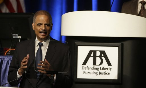 This Aug. 12, 2014 file photo shows Attorney Gen. Eric Holder speaking to the American Bar Association Annual Meeting in San Francisco. In remarks to the association, Holder said the Obama administration is calling for major changes to the nation's criminal justice system that would cut back the use of harsh sentences for certain drug-related crimes. Eric Holder, who is leading the federal response to the racial turmoil in Ferguson, Missouri, talks about the nation's civil rights struggles in a way none of the 81 previous U.S. attorneys general could _ by telling his own family story. (AP Photo/Eric Risberg, File)