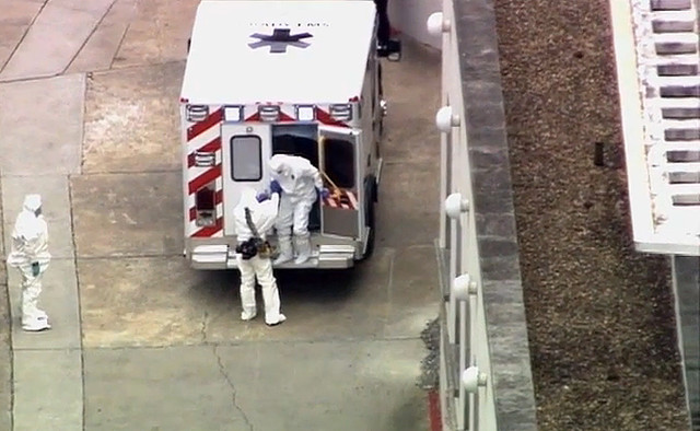 An ambulance arrives with U.S. doctor Kent Brantly, right, at Emory University Hospital, in Atlanta, on Saturday, Aug. 2, 2014. Brantly was flown from Liberia to Atlanta on Aug. 2, and is receiving treatment for Ebola at Emory University Hospital. (WSB-TV Atlanta/AP)