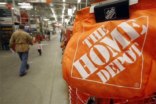 In this Feb. 22, 2010 file photo, shoppers walk through the aisles at the Home Depot store in Williston, Vt. The Home Depot on Thursday, Sept. 18, 2014 said it has eliminated malware from its U.S. and Canadian networks that affected 56 million unique payment cards between April and September. (AP Photo/Toby Talbot, File)