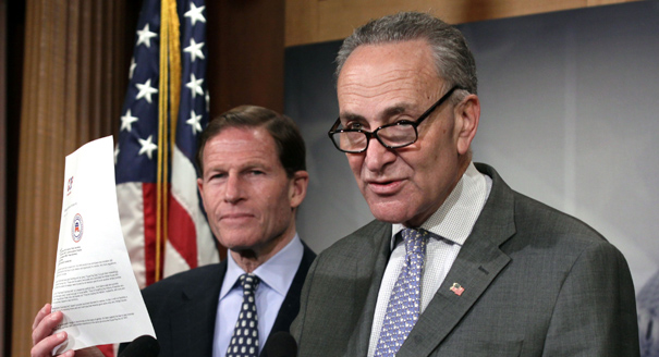 Sen. Charles Schumer, D-N.Y., right, accompanied by Sen. Richard Blumenthal, D-Conn., holds up a letter in opposition to the Paycheck Fairness Act during a news conference on Capitol Hill in Washington, Tuesday, April 8, 2014. (AP Photo/Lauren Victoria Burke)