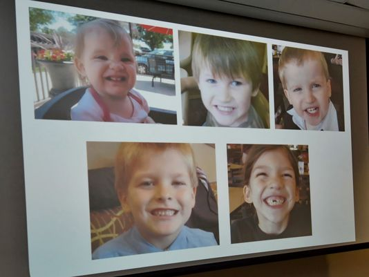 Photos of Timothy Ray Jones Jr.'s children are on display during a news conference at the Lexington County Sheriff's Department Training Center in Lexington, S.C., Sept. 10. Jones, 32, will be charged with murder in the deaths of his five children after he led authorities to a secluded clearing in Alabama, where their bodies were found wrapped in garbage bags. (Richard Shiro/AP)