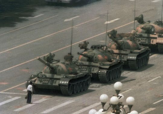 In this June 5, 1989 photo, a Chinese man stands alone to block a line of tanks heading east on Beijing's Changan Blvd. from Tiananmen Square.  Jeff Widener, AP)