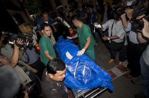 The body of slain British tourist, David Miller, wrapped in plastic sheet, is carried at a forensic police facility in Bangkok, Thailand, Tuesday, Sept. 16, 2014. Police on the scenic resort island of Koh Tao in southern Thailand conducted a sweep of hotels and workers' residences Tuesday searching for clues into the slayings of two British tourists whose nearly naked, battered bodies were found on a beach a day earlier. (AP Photo/Sakchai Lalit)