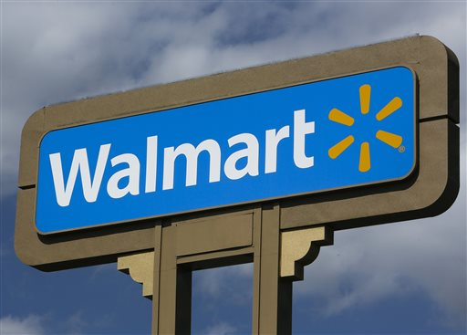This May 28, 2013, file photo, shows a sign outside a Wal-mart store in Duarte, Calif. Wal-Mart on Wednesday, Sept. 24, 2014 said it is launching a mobile checking account for its customers that will eliminate some of the fees charged by banks. (AP Photo/Damian Dovarganes, File)