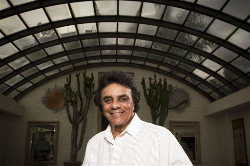 "In this Monday, Sept. 8, 2014 photo, singer Johnny Mathis poses for a portrait in Los Angeles. The 78-year-old singer will release a 13-CD box set of unsuccessful commercial albums released from 1963 to 1967, when Mathis left his longtime label, Columbia Records, for Mercury Records and Global Records, his own production company. ""The Complete Global Albums Collection"" will be released on Nov. 17. (Photo by Omar Vega/Invision/AP)"