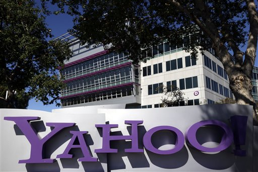 This Oct. 17, 2012, photo, shows a sign in front of Yahoo! headquarters in Sunnyvale, Calif. Yahoo says the government threatened to fine the company $250,000 a day if it did not comply with demands to go along with an expansion of U.S. surveillance laws by surrendering online information, a step the company regarded as unconstitutional. (AP Photo/Marcio Jose Sanchez, File)