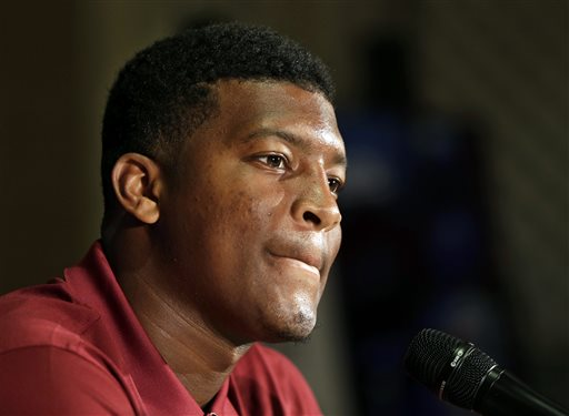 """In this July 20, 2014, file photo, Florida State's Jameis Winston answers a question during a news conference at the Atlantic Coast Conference Football kickoff in Greensboro, N.C.  Winston has made lewd comments about women and Florida State coach Jimbo Fisher says he is deciding whether to bench the Seminoles' quarterback for his """"derogatory"""" remarks. Several students tweeted Winston stood on campus Tuesday and shouted a lascivious comment that may have derived from an internet meme. (AP Photo/Chuck Burton, File)"""