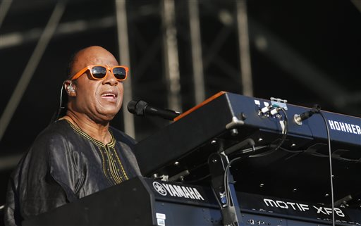 "In this June 29, 2014 file photo, US singer Stevie Wonder performs at the Calling festival, in London. Wonder said the mayor of Ferguson, Mo., isn't seeing the full picture a month after an unarmed black teenager was killed by a white police officer. ""I don't know if the mayor has blinders on,"" Wonder said in an interview Wednesday, Sept. 10, 2014. ""But to say that he didn't know that there was a racial or cultural problem in the city is unfortunate."" (Photo by Jim Ross/Invision/AP)"