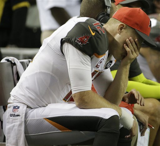 Tampa Bay Buccaneers quarterback Josh McCown (12) sits on the sidelines during the second half of an NFL football game against the Atlanta Falcons, Thursday, Sept. 18, 2014, in Atlanta. The Atlanta Falcons won 56-14. (AP Photo/David Goldman)
