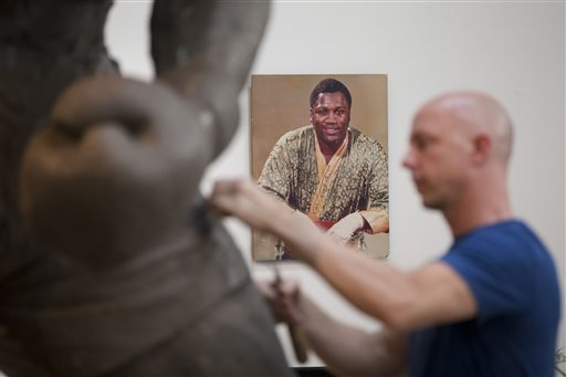 In this Aug. 14, 2014 photo, artist Stephen Layne works on a sculpture of boxing heavyweight champion Joe Frazier in Philadelphia. Next year, the sculpture is expected to be placed near the city's sports stadiums, ending a hurdle-strewn saga that included fundraising problems and the death of the original sculptor. Frazier died in 2011. (AP Photo/Matt Rourke)