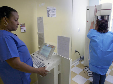 Toborcia Bedgood performs a mammogram to screen for breast cancer at the Elizabeth Center for Cancer Detection in Los Angeles in 2010. (Damian Dovarganes/AP)