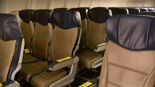 "In this Sept. 23, 2013 photo, rows of slimline seats await installation aboard a Southwest Airlines 737 at the carrier's headquarters in Dallas. ""Seats are getting closer together,"" says Sara Nelson, president of the Association of Flight Attendants, which represents 60,000 flight attendants at 19 airlines. (AP Photo/John Mone)"