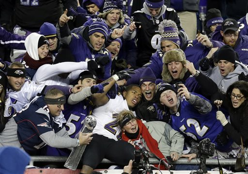 In this Jan. 20, 2013, file photo, Baltimore Ravens running back Ray Rice, center, is surrounded by fans in the stands as he celebrates winning the NFL football AFC Championship football game against the New England Patriots in Foxborough, Mass. Rice was let go by the Ravens on Monday, Sept. 8, 2014, and suspended indefinitely by the NFL after a video was released that appears to show the running back striking his then-fiancee in February. (AP Photo/Steven Senne)