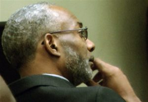 In this image taken from video, Rev. Juan McFarland listens to testimony during in a court hearing about the future of Shiloh Missionary Baptist Church in Montgomery, Ala., on Thursday, Oct. 16, 2014. McFarland, who members say admitted to adultery and drug use from the pulpit, is fighting an attempt to remove him from the pastorate. (AP Photo/Jay Reeves)