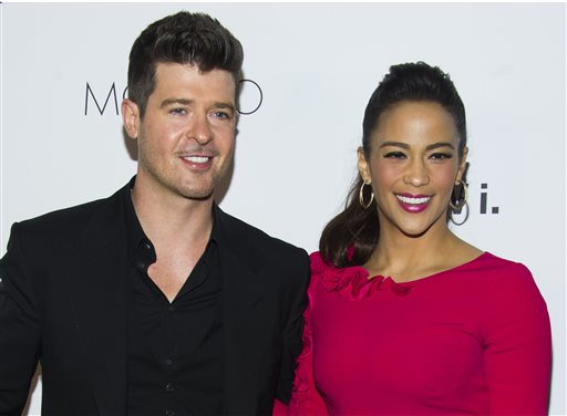 """In this Wednesday, Oct. 23, 2013 file photo, Robin Thicke and Paula Patton attend the sixth annual GQ Gentlemen's Ball in New York. Patton has filed for divorce from Thicke and is asking for joint custody of their son. Patton filed in Los Angeles on Friday, Oct. 3, 2014, citing """"irreconcilable differences."""" (Photo by Charles Sykes/Invision/AP, file)"""