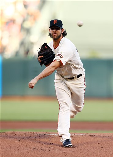San Francisco Giants pitcher Madison Bumgarner throws during the first inning of Game 5 of baseball's World Series against the Kansas City Royals Sunday, Oct. 26, 2014, in San Francisco. (AP Photo/Else, Pool)