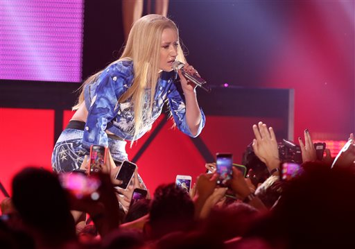 Iggy Azalea performs at the Vevo Certified SuperFanFest Live Concert at the Barker Hangar on Wednesday, Oct. 8, 2014, in Santa Monica, Calif. (Photo by Paul A. Hebert/Invision/AP)