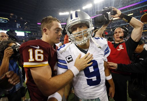 Washington Redskins' Colt McCoy (16) greets Dallas Cowboys' Tony Romo (9) on the field after an NFL football game, Monday, Oct. 27, 2014, in Arlington, Texas. Washington won in overtime 20-17. (AP Photo/Tim Sharp)