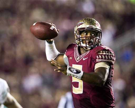 Florida State quarterback Jameis Winston rolls out to pass late in the second half of an NCAA college football game against Notre Dame in Tallahassee, Fla., Saturday, Oct. 18, 2014. Florida State won 31-27. (AP Photo/Mark Wallheiser)